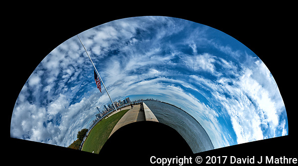 Little Planet View. Flag at half-mast and Manhattan skyline from Ellis Island. Composite of 33 images taken with a Fuji X-T2 camera and 18-55 mm zoom lens (ISO 200, 18 mm, f/5.6, 1/4700 sec). Raw images processed with Capture One Pro and AutoPano Giga Pro. (David J Mathre)