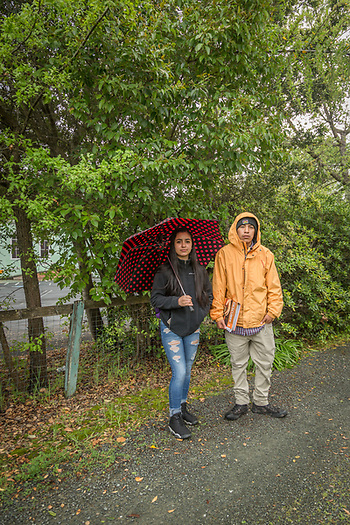 Highschool friends, Monce Padilla and Luis Vega walk home together on a rainy day in Calistoga. (Clark James Mishler)