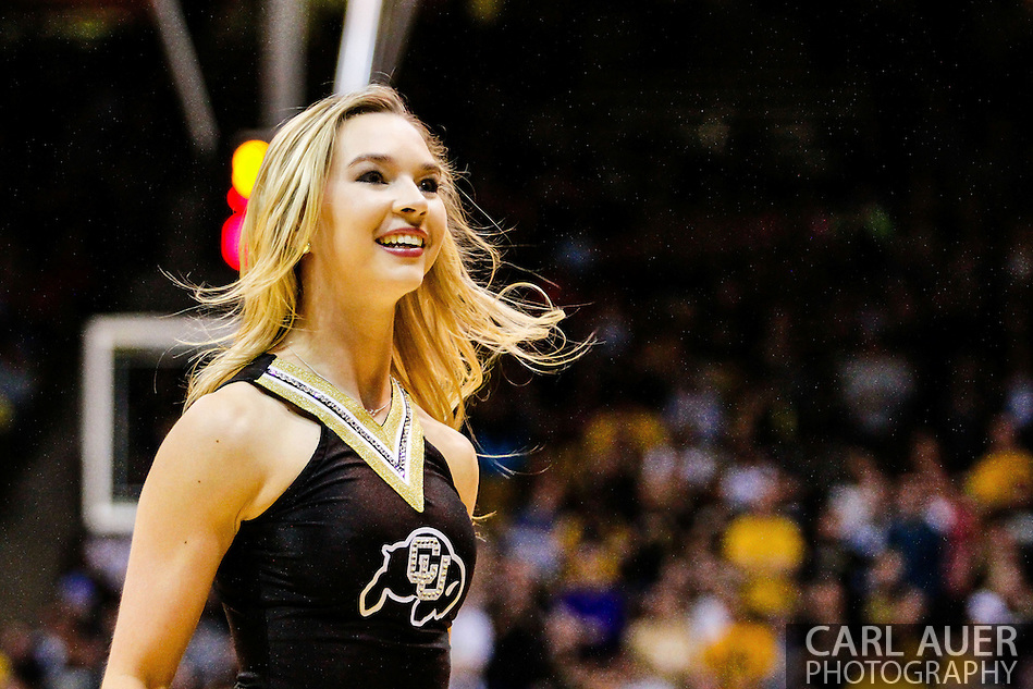 January 2nd, 2014:  A Colorado cheerleader during a break in second half action of the NCAA Basketball game between the Oregon State Beavers and the University of Colorado Buffaloes at the Coors Events Center in Boulder, Colorado (Carl Auer/ZUMAPRESS.com)