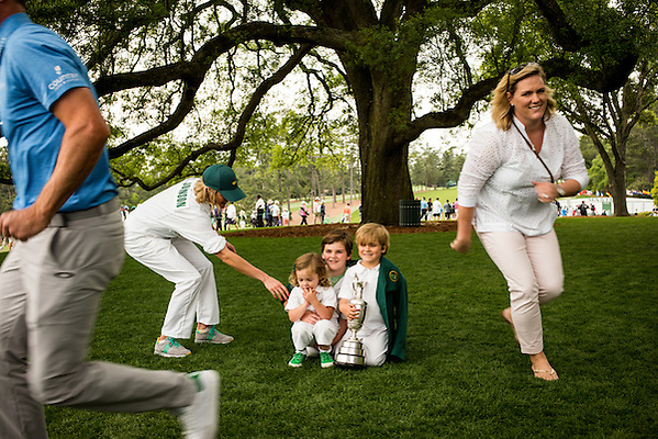 "Zach and Kim Johnson with kids under ""The Tree,"" Augusta National Golf Club, Wednesday, April 6 2016. Photograph ©2016 Darren Carroll (Darren Carroll)"