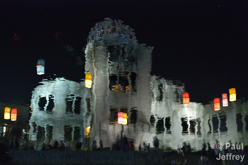 The reflection in the river of the atomic bomb dome in Hiroshima, Japan. Floating in the river are candle lanterns, thousands of which were launched on August 6, 2015, the 70th anniversary of the atomic bombing of the city. Each floating lantern carries handmade messages and drawings, conveying each person's prayers for peace and comfort for the victims of the violence. The dome is now a memorial to those killed and injured in the bombing. (Paul Jeffrey)