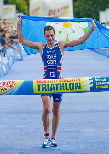 07 AUG 2011 - LONDON, GBR - Alistair Brownlee (GBR) carries the flag of Yorkshire as celebrates winning the men's round of triathlon's ITU World Championship Series and meeting the selection criteria for the British team for the 2012 Olympic Games .(PHOTO (C) NIGEL FARROW) (NIGEL FARROW/(C) 2011 NIGEL FARROW)
