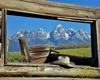 "Derilict log cabin, Cowboy hat, Grand Teton National Park, Jackson Hole, Wyoming. This was the cabin used in the movie ""Shane"" 1954 starring Allan Ladd. (© Daryl L. Hunter - The Hole Picture/Daryl L. Hunter)"