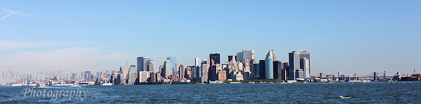 Panoramic view of the New York City skyline from the water south of Manhattan (Ian C Whitworth)