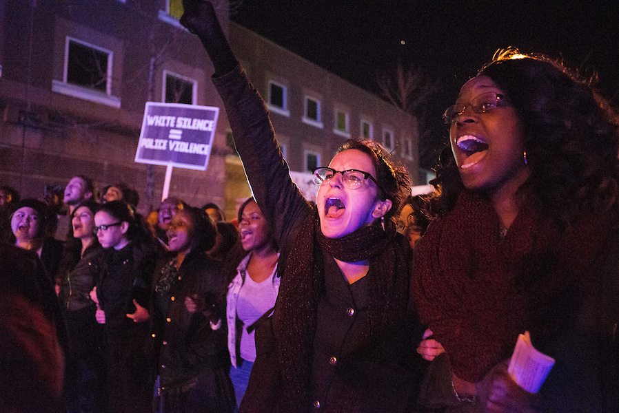11/25/14 – Medford/Somerville, MA – Protesters chant at police officers during the Indict America rally in Boston on November 25th, 2014. (Nicholas Pfosi / The Tufts Daily) (Nicholas Pfosi / The Tufts Daily)