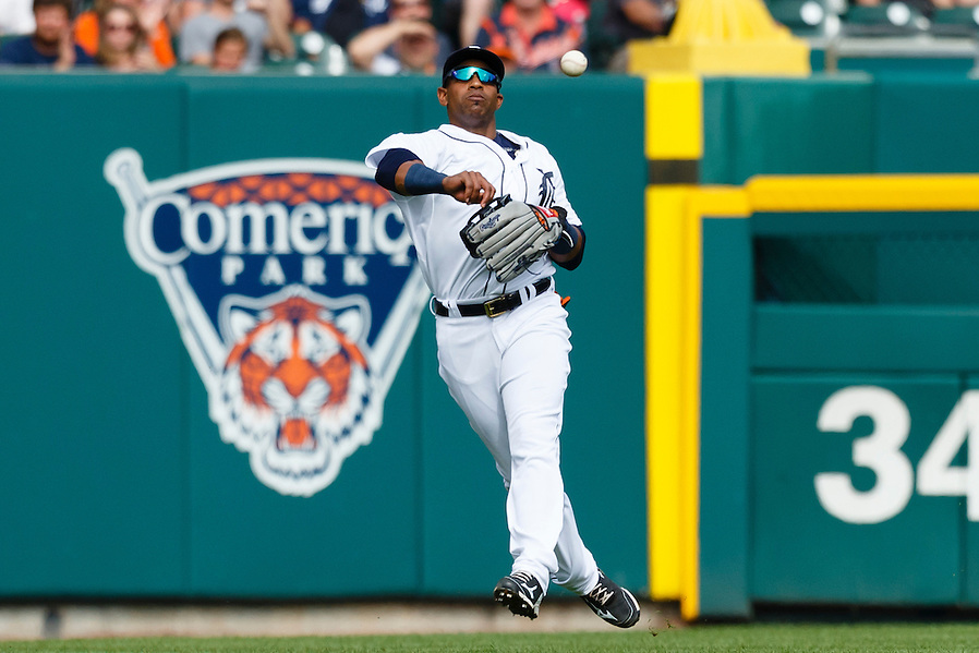 Jun 13, 2015; Detroit, MI, USA; Detroit Tigers left fielder Yoenis Cespedes (52) makes a throw in the fourth inning against the Cleveland Indians at Comerica Park. Mandatory Credit: Rick Osentoski-USA TODAY Sports (Rick Osentoski/Rick Osentoski-USA TODAY Sports)