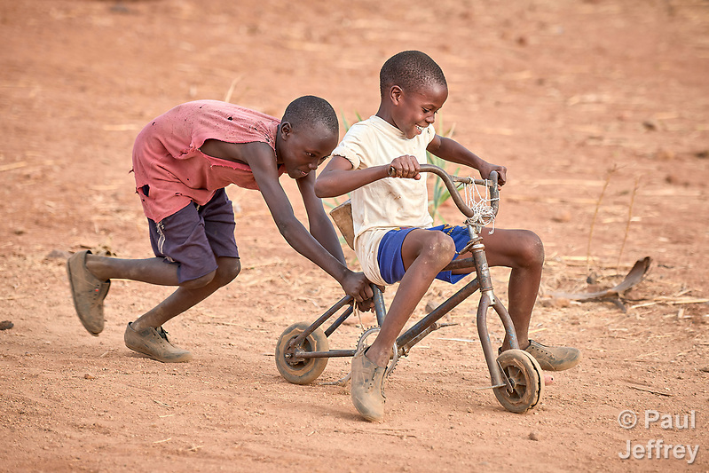 Boys play with a rehabilitated bicycle in Lugi, a village in the Nuba Mountains of Sudan. The area is controlled by the Sudan People's Liberation Movement-North, and frequently attacked by the military of Sudan. (Paul Jeffrey)