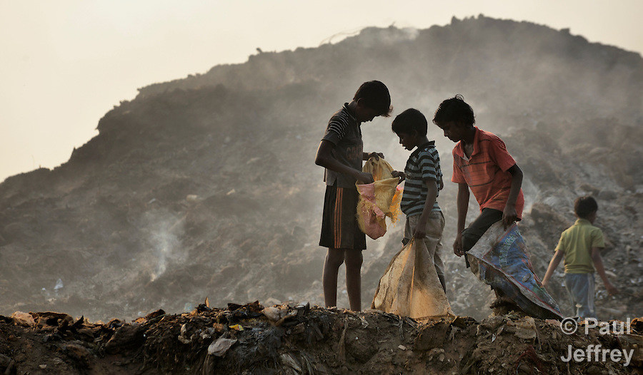 Boys scavenge in the municipal garbage dump in Chennai, India. They spend their nights safely in a shelter sponsored by the Madras Christian Council of Social Service.