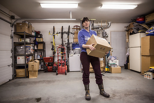 Neighbor Meghan Kim offers her organizational skills during the first day of packing in preparation of our September departure from Alaska.  It is now official. (© Clark James Mishler)