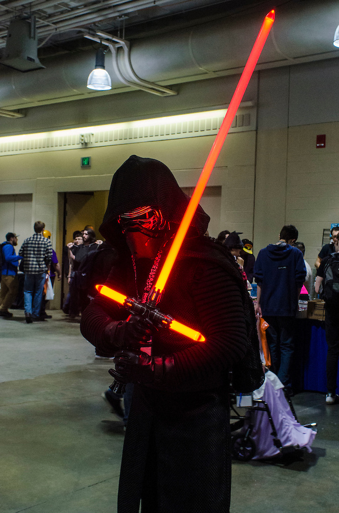 3/25/16 - Medford/Somerville, MA - A convention attendee dressed as Kylo Ren from Star Wars poses with a lightsaber at fan convention Anime Boston in the Hynes Convention Center on Friday, Mar 25, 2016. (Ray Bernoff / The Tufts Daily) (Ray Bernoff)