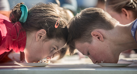 Head to head at the pie eating contest at the Alaska State Fair (Clark James Mishler)