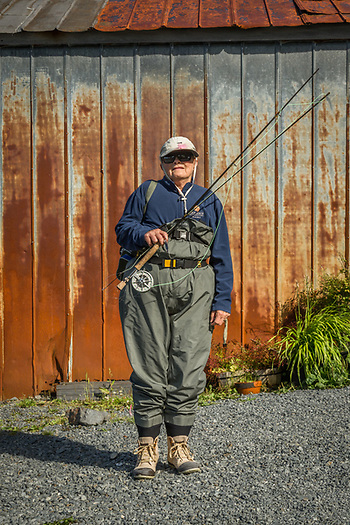 Local fisher person Carol Odess prepares to challenge the incoming tide in Sitka, Alaska (Clark James Mishler)