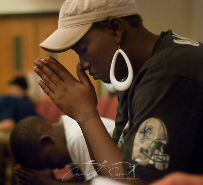 Shelita Woods-Muse and her son, Rashad Woods, bow their heads during a Community Crisis prayer service May 26, 2010 at First Baptist Church in Chalmette, La. Nearly 100 coastal residents attended the service to pray for protection, comfort, guidance, and mercy as BP continues to battle the oil spill in the Gulf of Mexico. (Photo by Carmen K. Sisson/Cloudybright) (Carmen K. Sisson/Cloudybright)