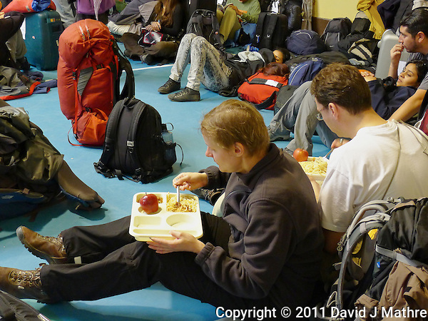 Pasta Lunch in the E 3 School Auditorium. Red Cross Refuge Center, Puerto Natales E3 School. Snapshot taken with a Leica D-Lux 5 camera (ISO 400, 10 mm, f/2.6, 1/20 sec). (David J Mathre)
