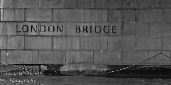 A view under the London Bridge at the name in B&W (Ian C Whitworth)