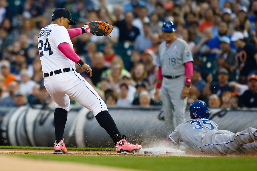 May 10, 2015; Detroit, MI, USA; Kansas City Royals first baseman Eric Hosmer (35) is out diving into first as Detroit Tigers first baseman Miguel Cabrera (24) tags the base in the first inning at Comerica Park. Mandatory Credit: Rick Osentoski-USA TODAY Sports (Rick Osentoski/Rick Osentoski-USA TODAY Sports)