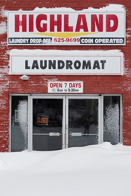 Highland Laundromat, which is normally open 7 days a week, was closed after Winter Storm Nemo dropped about 2 feet of snow overnight on Somerville, Massachusetts, U.S., on Saturday, Feb. 9, 2013. Kelvin Ma/Bloomberg