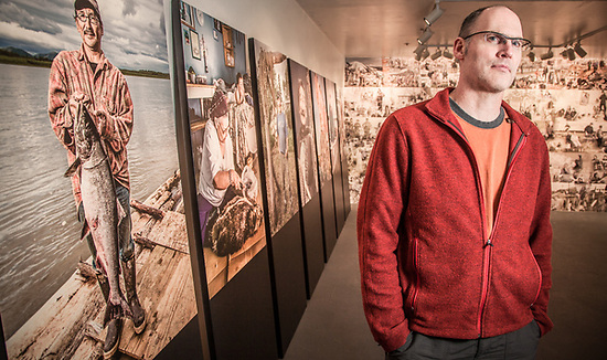 Photographer, Kevin Smith, with his portrait show at the International Gallery, Anchorage. (Clark James Mishler)