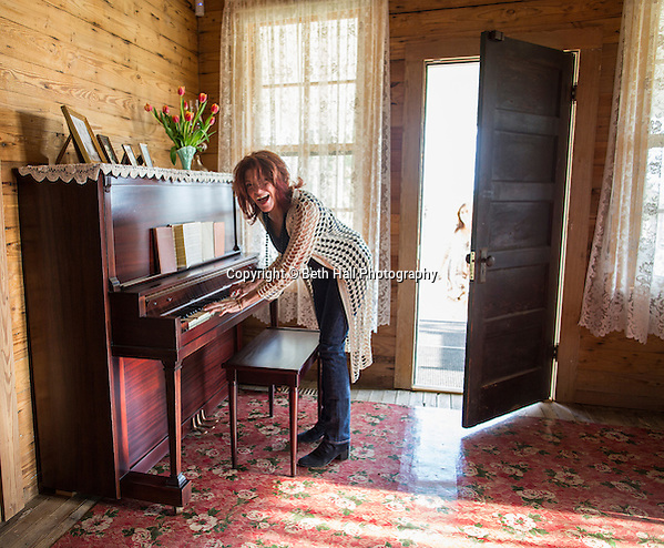 Rosanne Cash laughs after playing the original Cash family piano in the boyhood home of her father Johnny Cash for the first time since it was fully restored on Saturday, August 16, 2014, in Dyess, Ark. The home was restored to it's appearance when the Cash family lived in it, from 1935-1954, and was part of The Dyess Colony that was created in 1934 as part of President Franklin D. Roosevelt's New Deal. Photo by Beth Hall (Beth Hall)