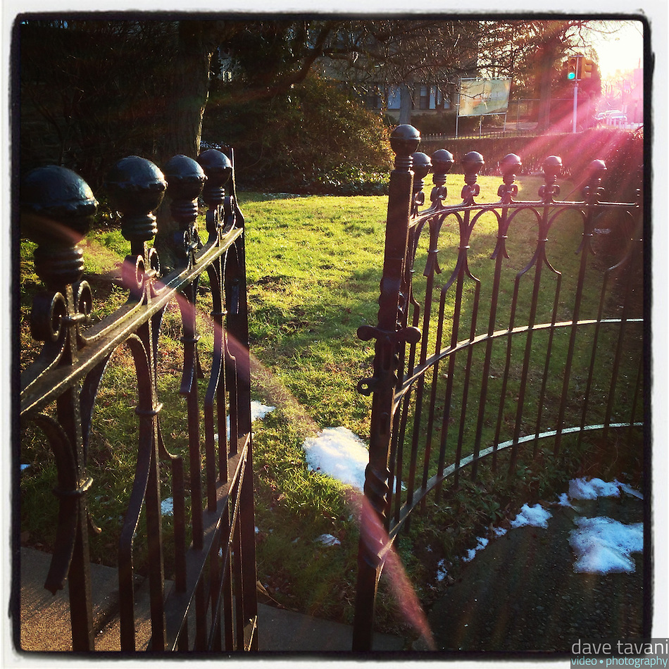 The sun shines through an open gate on Johnson Street in the Germantown section of Philadelphia on January 7, 2013. (Dave Tavani)