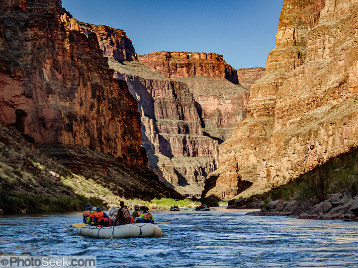 Canyon walls tower over our boats on Day 13 of 16 days rafting 226 miles down the Colorado River in Grand Canyon National Park, Arizona, USA. (© Tom Dempsey / PhotoSeek.com)