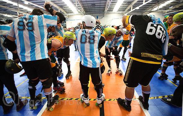 16 MAR 2014 - BIRMINGHAM, GBR - Argentina skaters form part of the tunnel for the Wizards of Aus team after their bout at the inaugural Men's Roller Derby World Cup in the Futsal Arena in Birmingham, West Midlands, Great Britain (PHOTO COPYRIGHT © 2014 NIGEL FARROW, ALL RIGHTS RESERVED) (NIGEL FARROW/COPYRIGHT © 2014 NIGEL FARROW : www.nigelfarrow.com)
