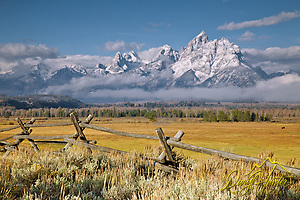 The first snow on the Grand Tetons in Grand Teton National Park. A buckrail rail fence accents the western heritage of the Jackson Hole Valley. (Daryl Hunter's &quot;The Hole Picture&quot;  Daryl L. Hunter has been photographing the Yellowstone Region since 1987, when he packed up his view camera, Pentex 6X7, and his 35mms and headed to Jackson Hole Wyoming. Besides selling photography Daryl also publ/Daryl L. Hunter)