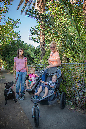 Jamey Blood with her daughter Gwynnevere and their dog, Sinckers, out for a walk with her friend Erinn Maloney with her son, Nathan, on Filmore Street in Calistoga (Clark James Mishler)