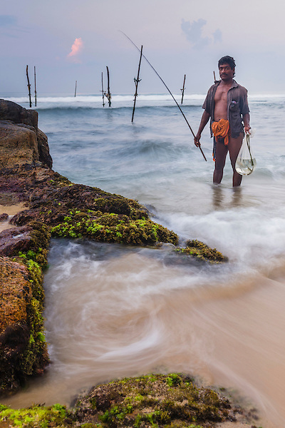 Portrait of a stilt fisherman at Midigama near Weligama, South Coast, Sri Lanka, Asia. This is a portrait photo of a stilt fisherman at Midigama near Weligama on the South Coast of Sri Lanka, Asia. This stilt fisherman is continuing a traditional way of fishing in Sri Lanka.