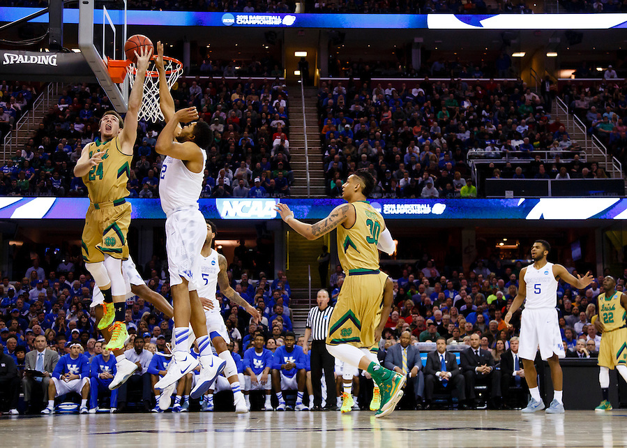 Mar 28, 2015; Cleveland, OH, USA; Notre Dame Fighting Irish guard/forward Pat Connaughton (24) goes to the basket defended by Kentucky Wildcats forward Karl-Anthony Towns (12) in the finals of the midwest regional of the 2015 NCAA Tournament at Quicken Loans Arena. Mandatory Credit: Rick Osentoski-USA TODAY Sports (Rick Osentoski/Rick Osentoski-USA TODAY Sports)