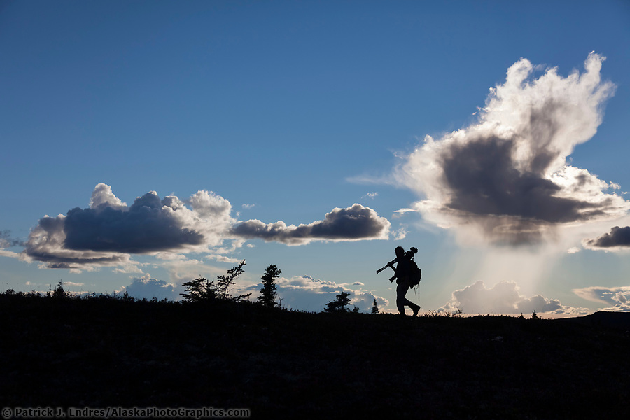 Photographer silhouetted against the sky in Denali National Park. (Patrick J Endres / AlaskaPhotoGraphics.com)