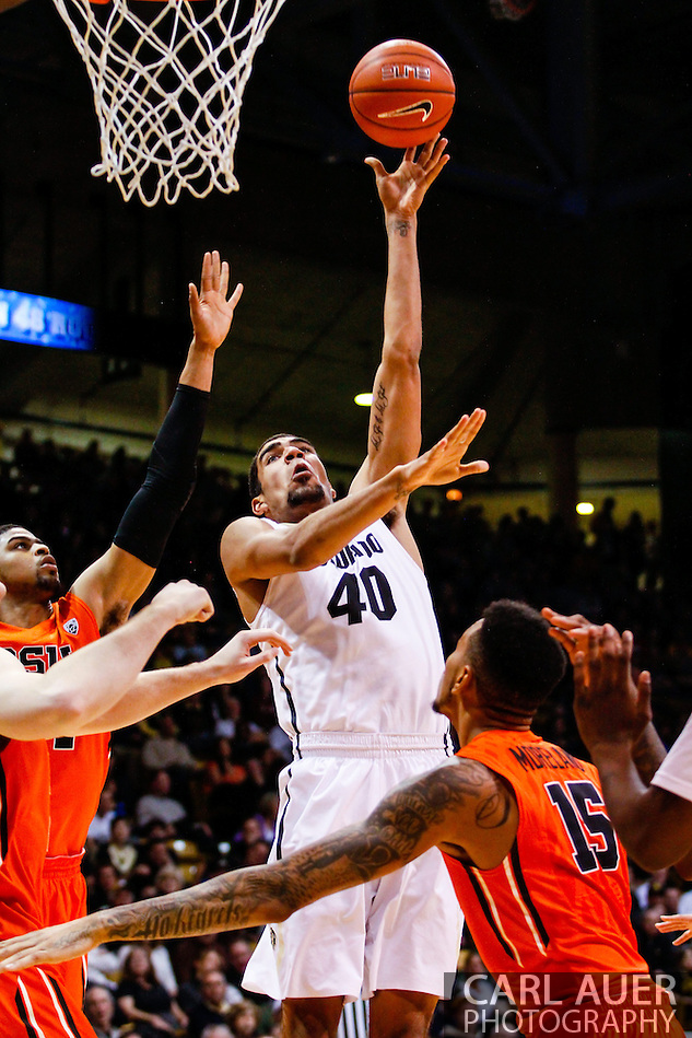 January 2nd, 2014:  Colorado Buffaloes sophomore forward Josh Scott (40) puts up a hook shot in the second half of the NCAA Basketball game between the Oregon State Beavers and the University of Colorado Buffaloes at the Coors Events Center in Boulder, Colorado (Carl Auer/ZUMAPRESS.com)
