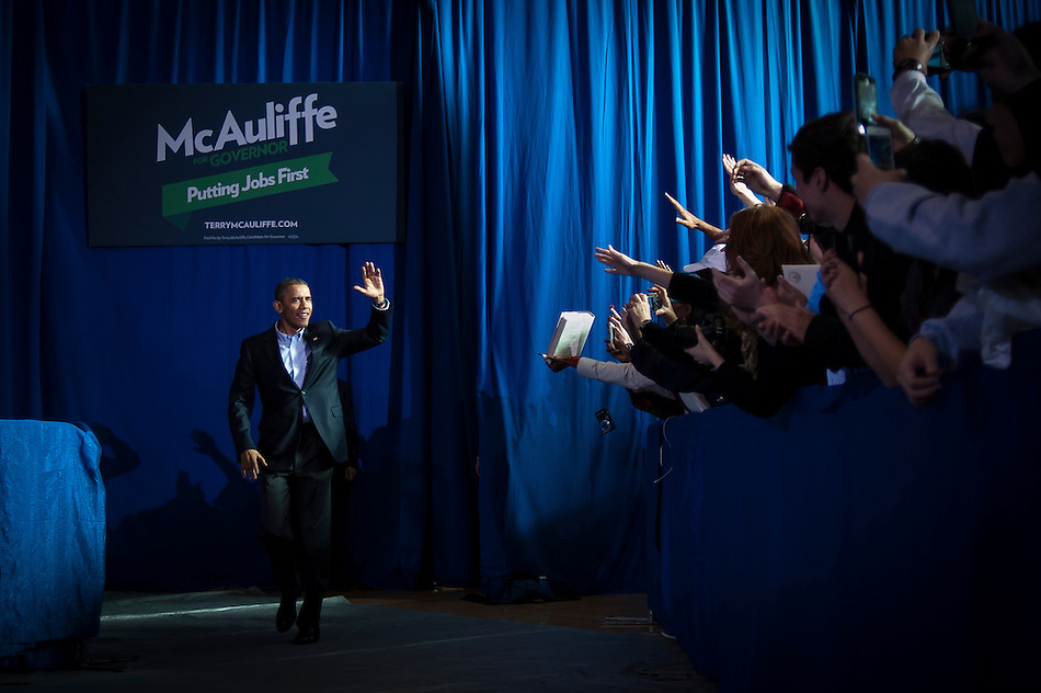 President Obama arrives to delivers remarks at a Terry McAuliffe campaign event at Washington-Lee High School, Arlington, Virginia, U.S., on Sunday, November 3, 2013. McAuliffe is the Democratic nominee in the 2013 Virginia gubernatorial election. Photographer: Pete Marovich/Bloomberg (Pete Marovich/Bloomberg)
