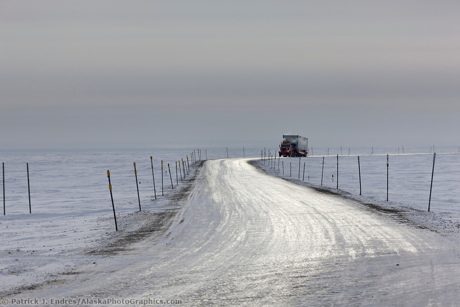 Trucking photos: Semi tractor trailer travels the James Dalton Highway near Prudhoe Bay, Arctic North Slope, Alaska. (Patrick J. Endres / AlaskaPhotoGraphics.com)
