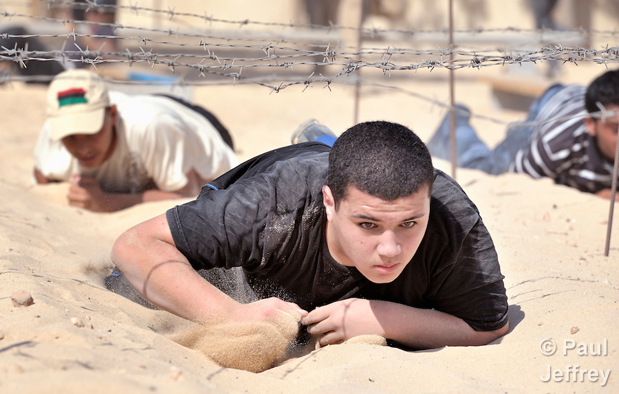Libyan rebels have suffered heavy losses on the battlefield in their war against strongman Moammar Gadhafi, so replacements are needed. At a training center in the rebel enclave of Misrata, recruits go through a 20-day training program to prepare them for the frontline. Training includes activities such as crawling in sand under barbed wire.