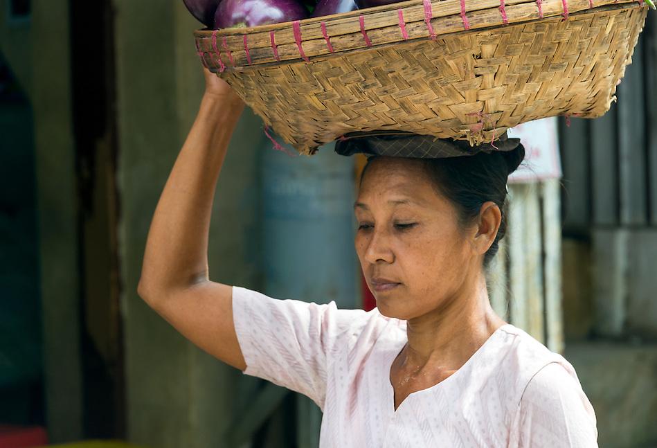 YANGON, MYANMAR - CIRCA DECEMBER 2013: Portrait of Burmese woman walking in the streets of Yangon. (Daniel Korzeniewski)