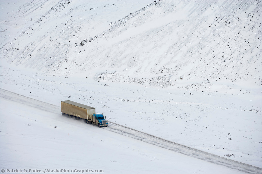 Trucking photos: Truck hauls supplies over atigun pass in the Brooks Range, Arctic, Alaska. (Patrick J Endres / AlaskaPhotoGraphics.com)