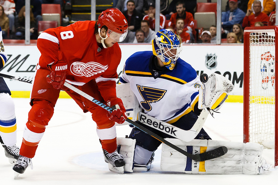 Mar 22, 2015; Detroit, MI, USA; St. Louis Blues goalie Jake Allen (34) makes a save on Detroit Red Wings left wing Justin Abdelkader (8) in the third period at Joe Louis Arena. Detroit won 2-1 in overtime. Mandatory Credit: Rick Osentoski-USA TODAY Sports (Rick Osentoski/Rick Osentoski-USA TODAY Sports)