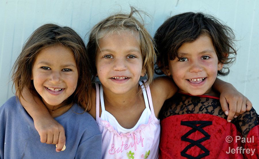 Three Roma girls whose families were expelled in 2012 from the center of Belgrade and relocated in shipping containers in the village of Makis, outside the Serbian capital. Their former homesite was considered a squalid eyesore that the city wants to develop with high-rise apartments and high rent retail outlets.