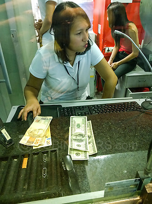 How can changing money be so complicated and time consuming. Just give me my money dammit! 15 mins to change US$300 into Brazilian Reais at Sao Paulo airport, Brazil. Madness. Photo by Andrew Tobin/Tobinators Ltd (Andrew Tobin/Tobinators)