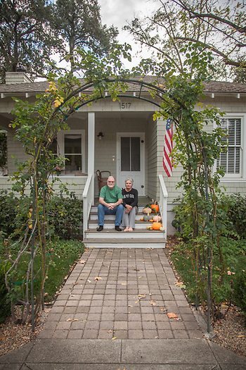 """When I bought this house in 1989, my twelve year old son explained: ' I can't believe you bought this dump!' Now, he can't wait for me to die."" -Retired Architect Tim Wilkes with his wife, Leslie, in front of their 115 year old home on Cedar Street in Calistoga. timothy.wilkes@gmail.com (© Clark James Mishler)"