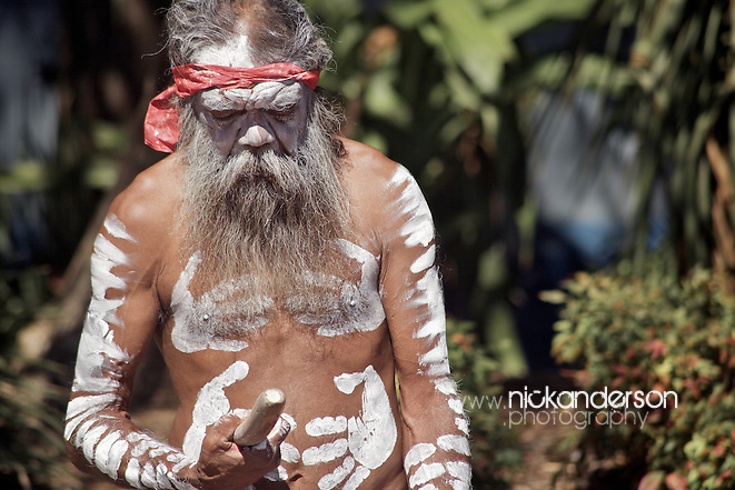 An indigenous Australian man rests between songs at an outdoor musical performance on Sydney's Circular Quay (Nick Anderson)