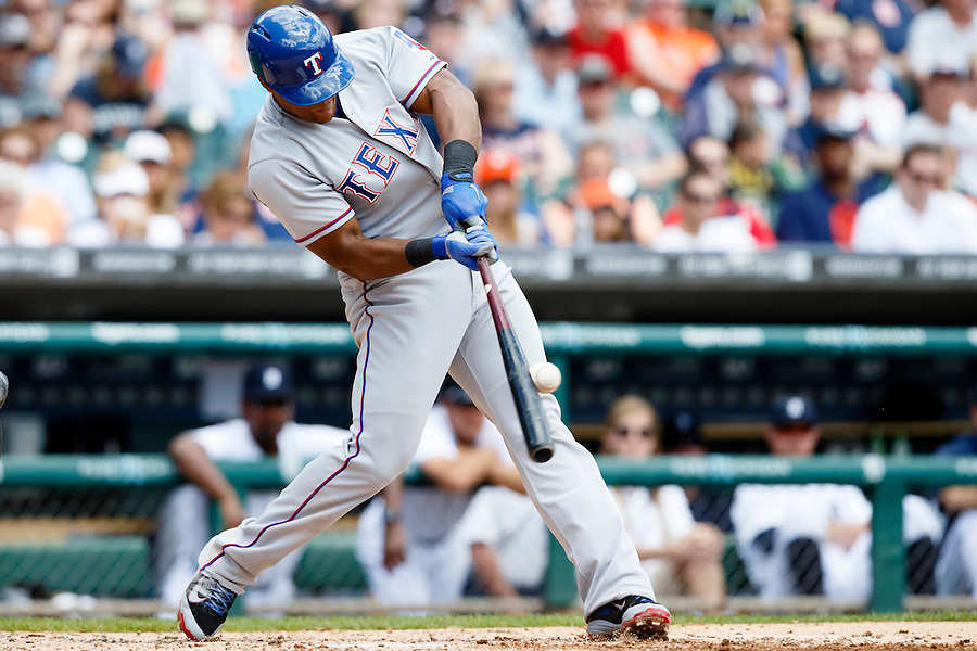 May 22, 2014; Detroit, MI, USA; Texas Rangers third baseman Adrian Beltre (29) hits a two RBI double in the third inning against the Detroit Tigers at Comerica Park. Mandatory Credit: Rick Osentoski-USA TODAY Sports (Rick Osentoski/Rick Osentoski-USA TODAY Sports)