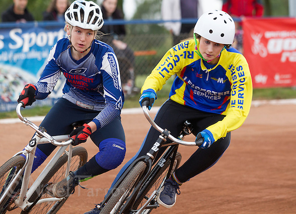 13 SEP 2014 - IPSWICH, GBR -Laura Watson (right) of Leicester Monarchs holds off Danni Riley (left) of Hethersett Hawks during a heat at the 2014 British Women's Club Cycle Speedway Championships at Whitton Sports & Community Centre in Ipswich, Great Britain (PHOTO COPYRIGHT © 2014 NIGEL FARROW, ALL RIGHTS RESERVED) (NIGEL FARROW/COPYRIGHT © 2014 NIGEL FARROW : www.nigelfarrow.com)
