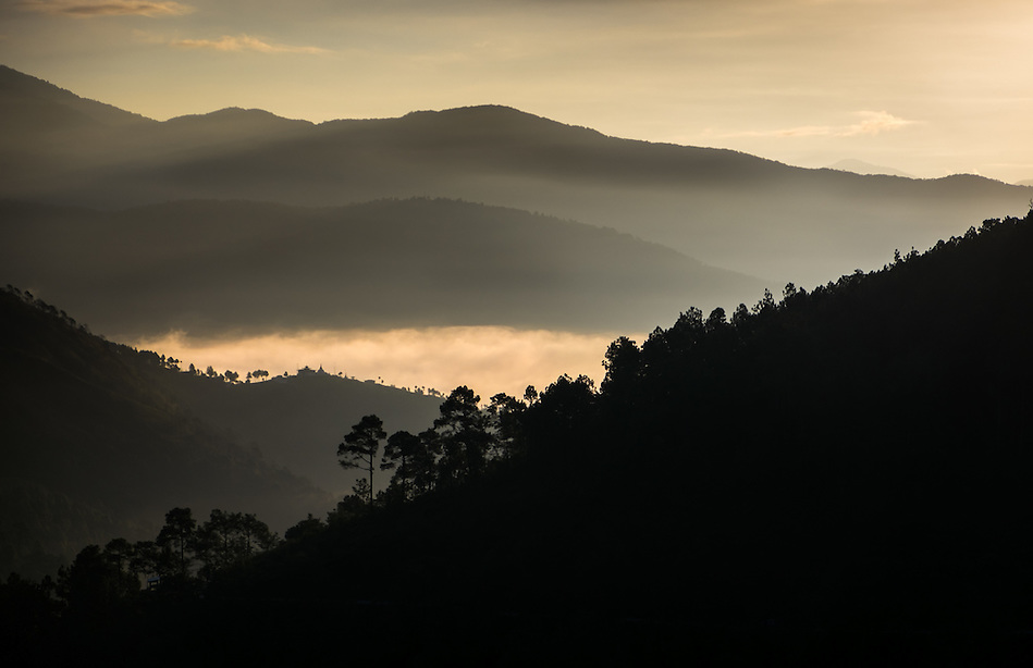 THIMPHU, BHUTAN - CIRCA October 2014: Sunrise over the mountains in Thimphu, Bhutan (Daniel Korzeniewski)