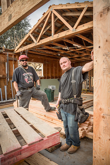 "Construction workers Jose Ramos and Jesse Lasorta work on a house project at Cedar and Lilly Streets in  Calistoga.  ""We live in San Franciso but we spend Monday through Friday here...we live in a trailer behind the project.""  jesselasorta@hotmail.com (Clark James Mishler)"