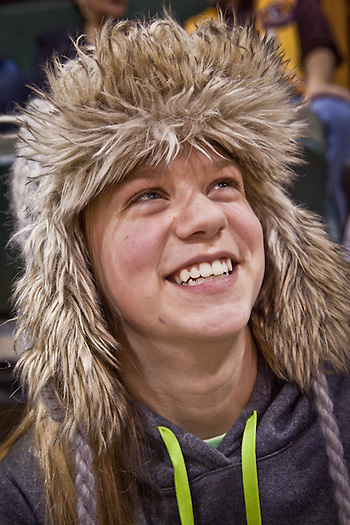 Spectaor and young basketball player, Larissa Parker, UAA Women's basketball game, Anchorage (Clark James Mishler)
