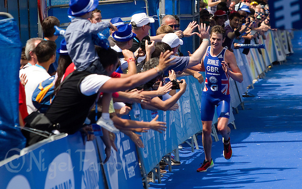 27 MAY 2012 - MADRID, ESP - Jonathan Brownlee (GBR) of Great Britain celebrates winning the men's 2012 World Triathlon Series round in Casa de Campo, Madrid, Spain .(PHOTO (C) 2012 NIGEL FARROW) (NIGEL FARROW/(C) 2012 NIGEL FARROW)