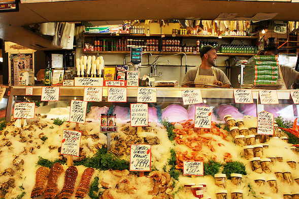 Counter at the world famous fish stand in the Pike Place Market, Seattle, USA. Here fishmongers sing, throw fish in the air and generally entertain the crowd. Oh - and they also sell some fish. (Abigail King)