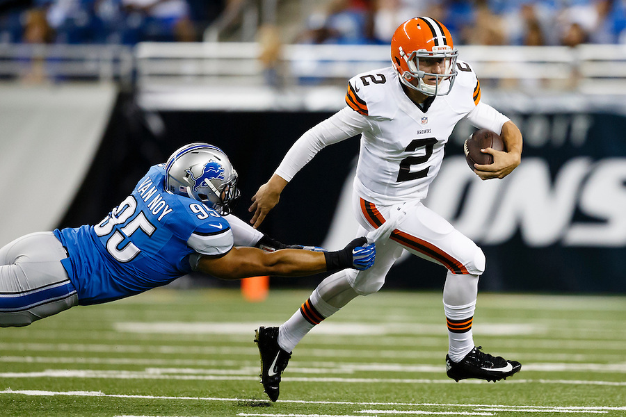 Cleveland Browns quarterback Johnny Manziel (2) breaks the tackle of Detroit Lions outside linebacker Kyle Van Noy (95) in the first half of a preseason NFL football game at Ford Field in Detroit, Saturday, Aug. 9, 2014.  (AP Photo/Rick Osentoski) (Rick Osentoski/AP)